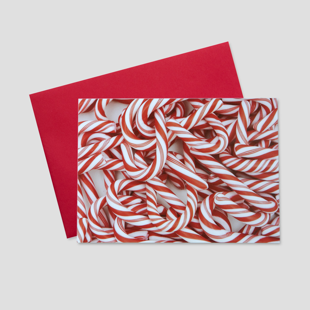 Corporate Holiday greeting card featuring a pile of red and white striped candy canes