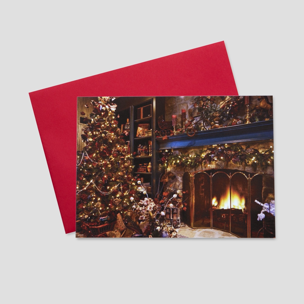 Client Holiday greeting card featuring a warming hearth, a decorated Christmas tree adorned by presents, stockings hanging by the mantle; the perfect scene of the holidays