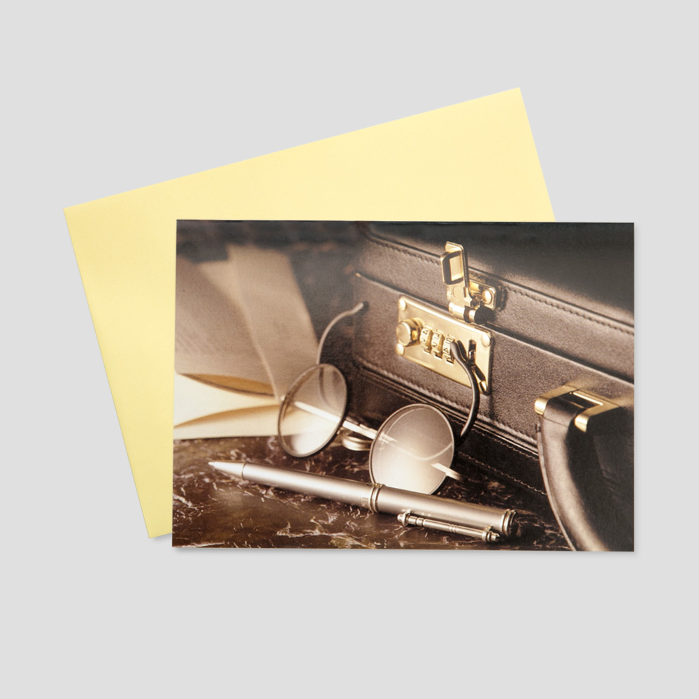 Business keep in touch greeting card featuring all of the work essentials  in an office; a brief case, reading glasses, and writing utensils