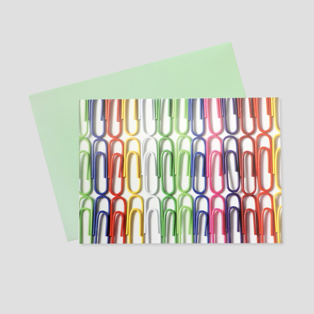 Work keep in touch greeting card featuring rows of bright, neon colored paper clips