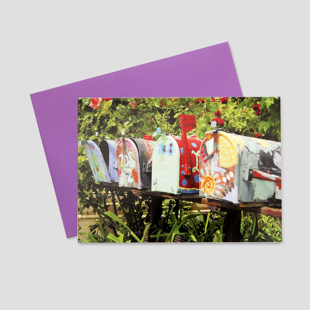 Customer keep in touch greeting card featuring a row of rustic, brightly colored mailboxes