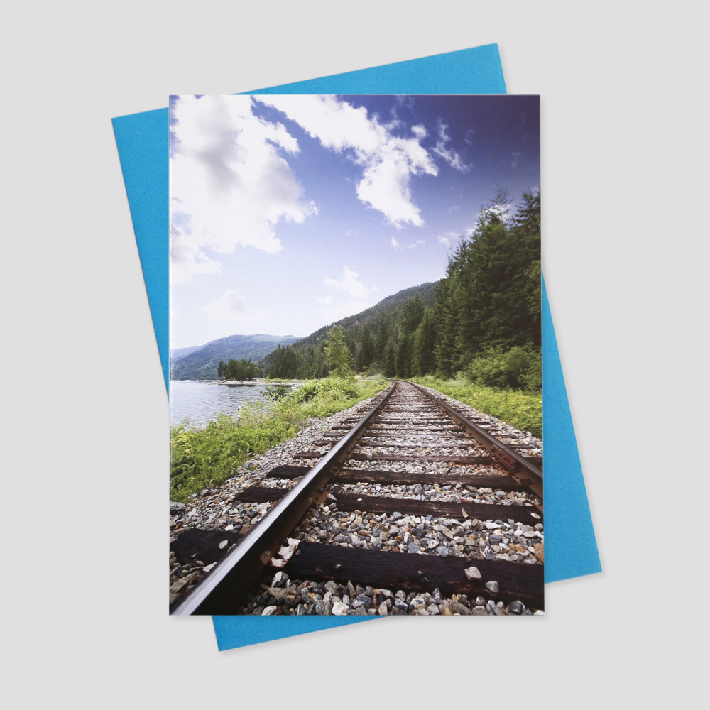 Employee keep in touch greeting card featuring a train track running across a wide open landscape on a bright, blue sky day