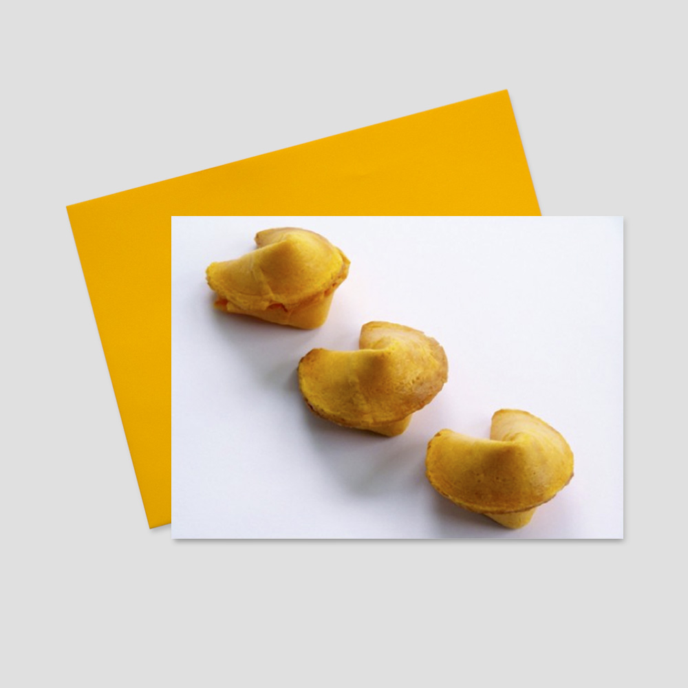 Keep in touch greeting card featuring a row of delicious fortune cookies on a white background