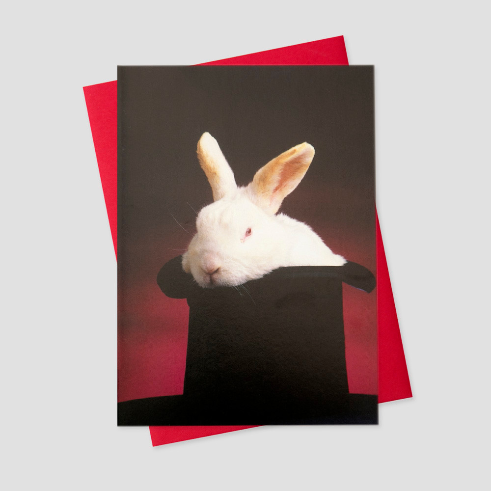 Client keep in touch greeting card featuring a red background, black top hat, and a white rabbit popping out from the bottom of the hat