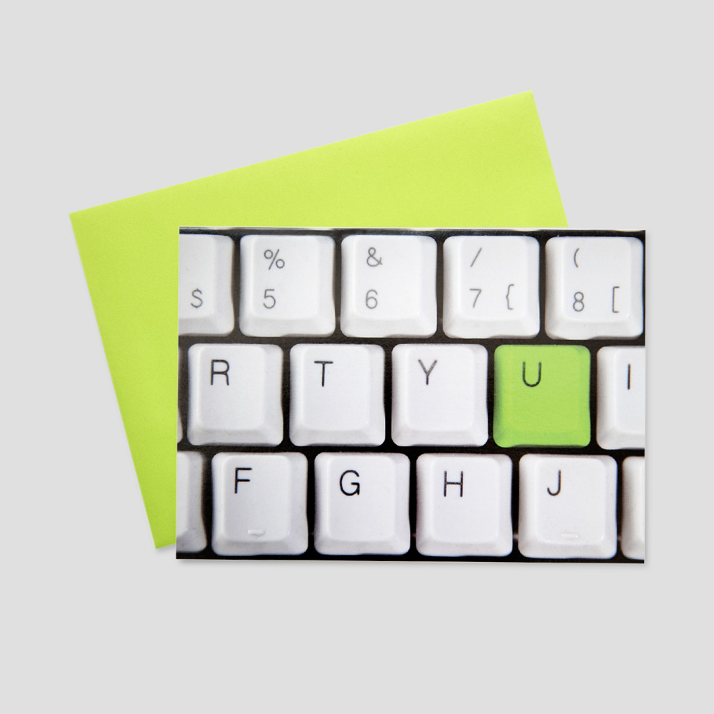 Company leep in touch greeting card featuring a close-up view of a keyboard with the letter U colored in lime green