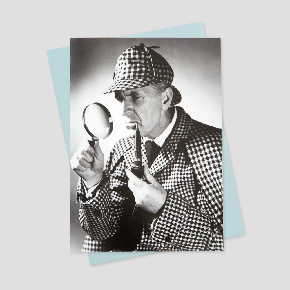 Keep in touch card featuring a black and white image of a detective staring into a magnifying glass