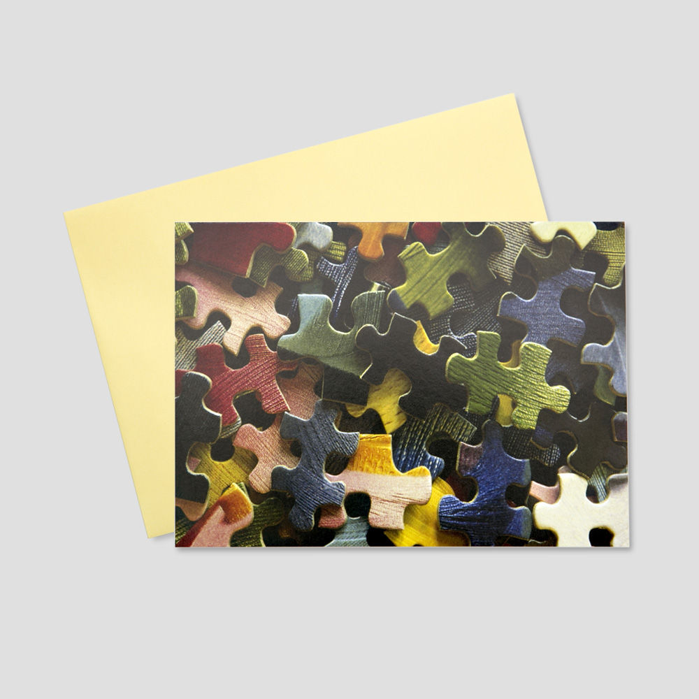 Keep in touch business greeting card featuring an array of colorful puzzle pieces