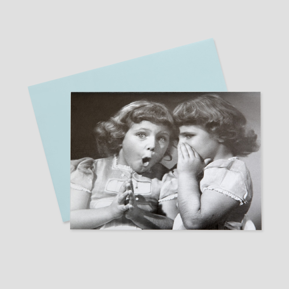 Employee keep in touch greeting card with a black and white image of two girls telling secrets to each other