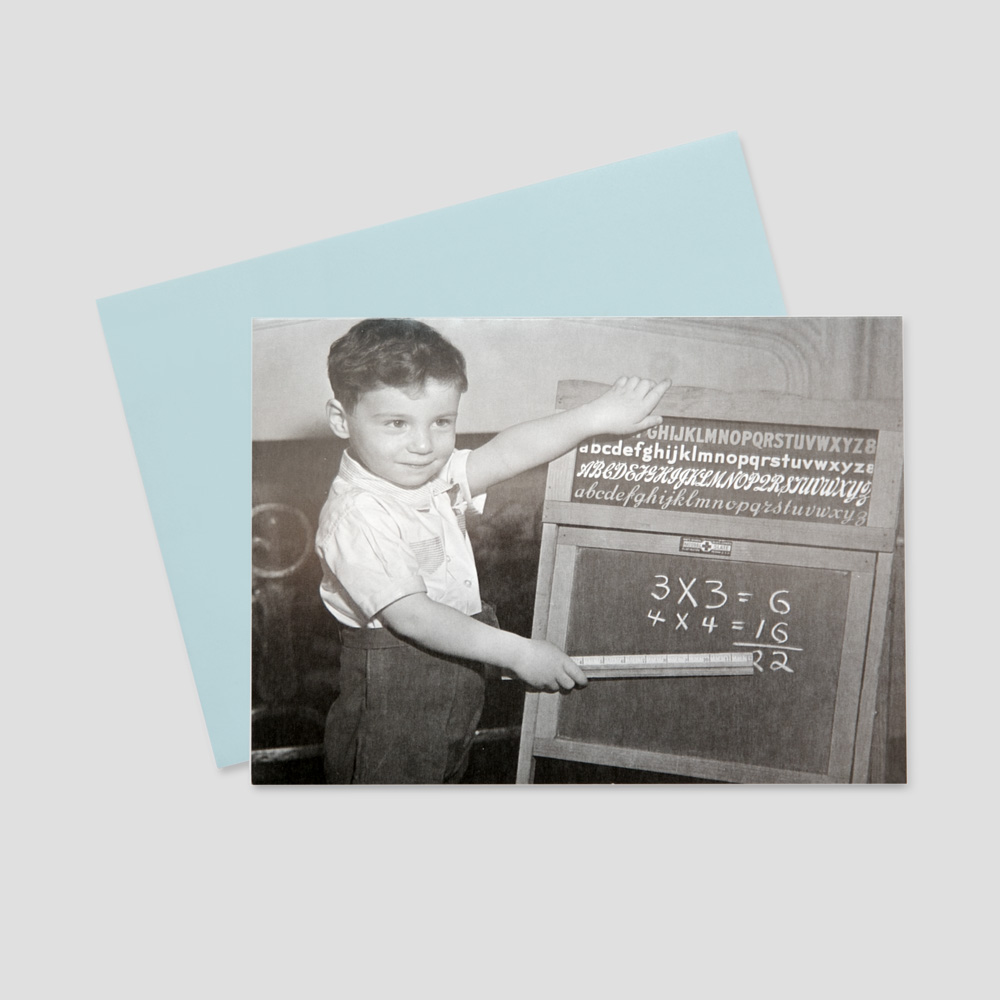Business keep in touch greeting card featuring a black and white photo of a boy adding up the wrong numbers on a chalkboard