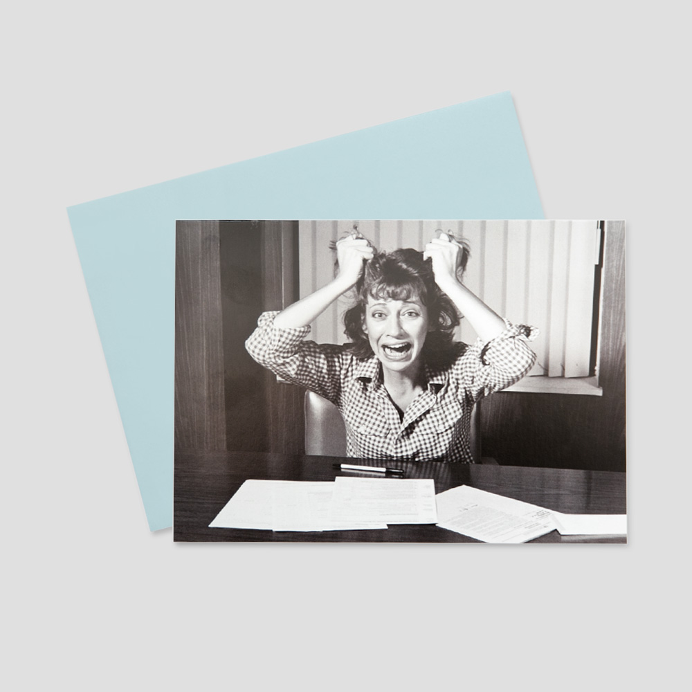 Company keep on touch greeting card featuring a black and white image of a woman screaming and pulling her hair out in surprise