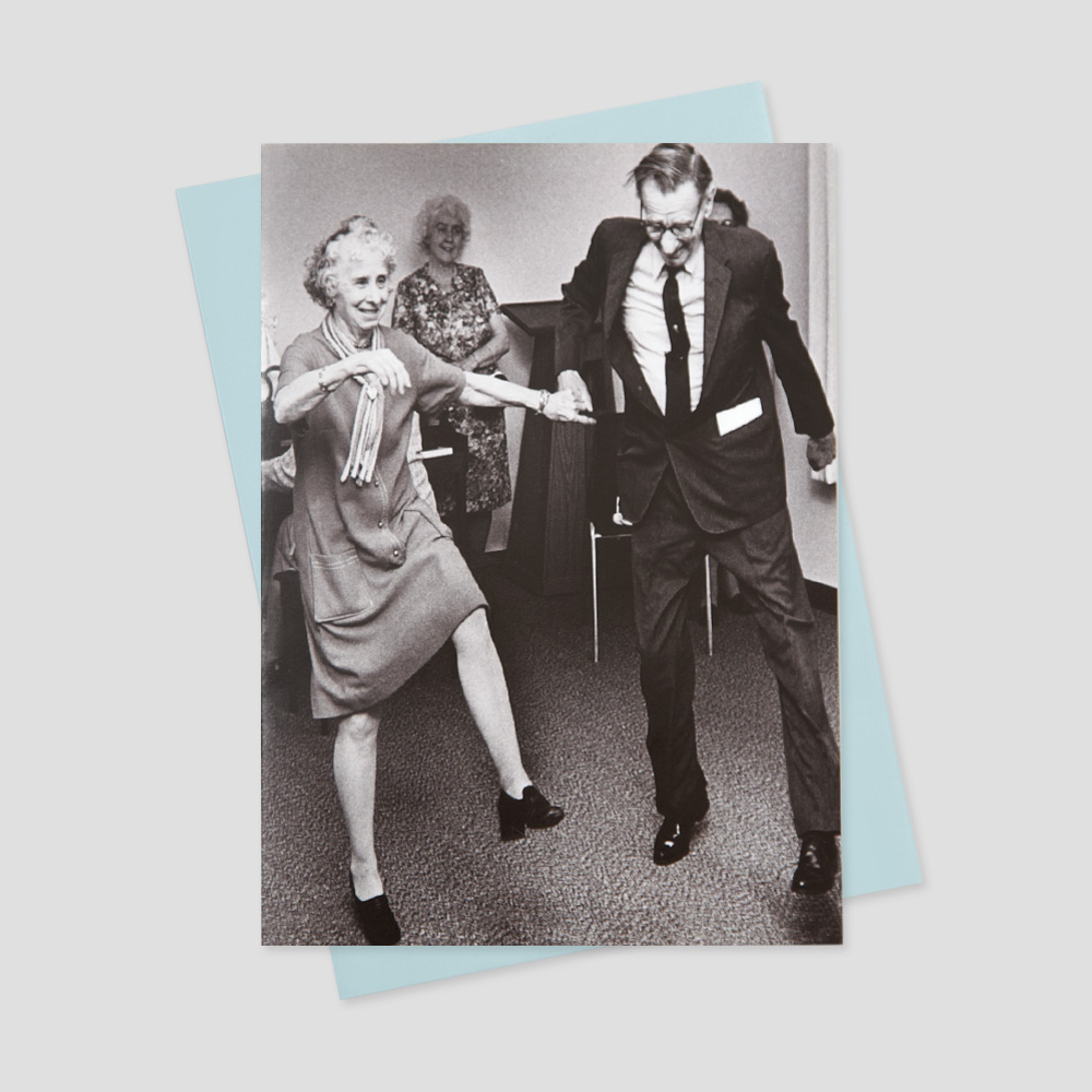 Business keep in touch greeting card featuring a black and white image of two old people dancing while holding hands