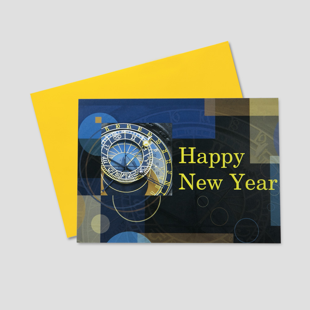 Business new year greeting card featuring a clock striking midnight and a happy new year message