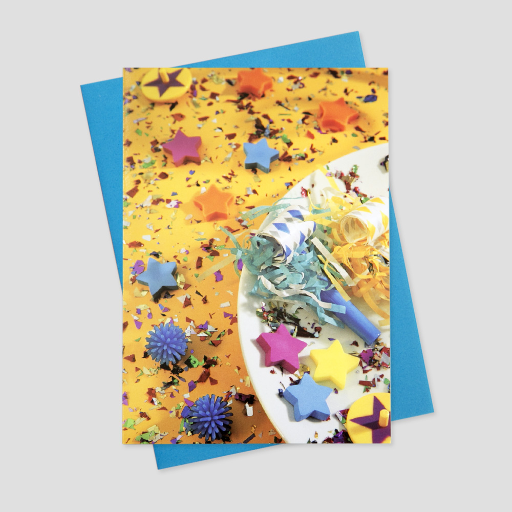 Client new year greeting card featuring an image of colorful confetti and party elements after the clock has struck midnight