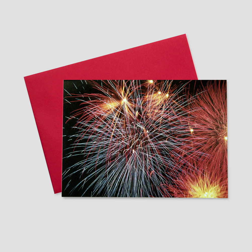 Corporate Patriotic greeting card featuring a dark background and red, blue and yellow fireworks lighting the night sky
