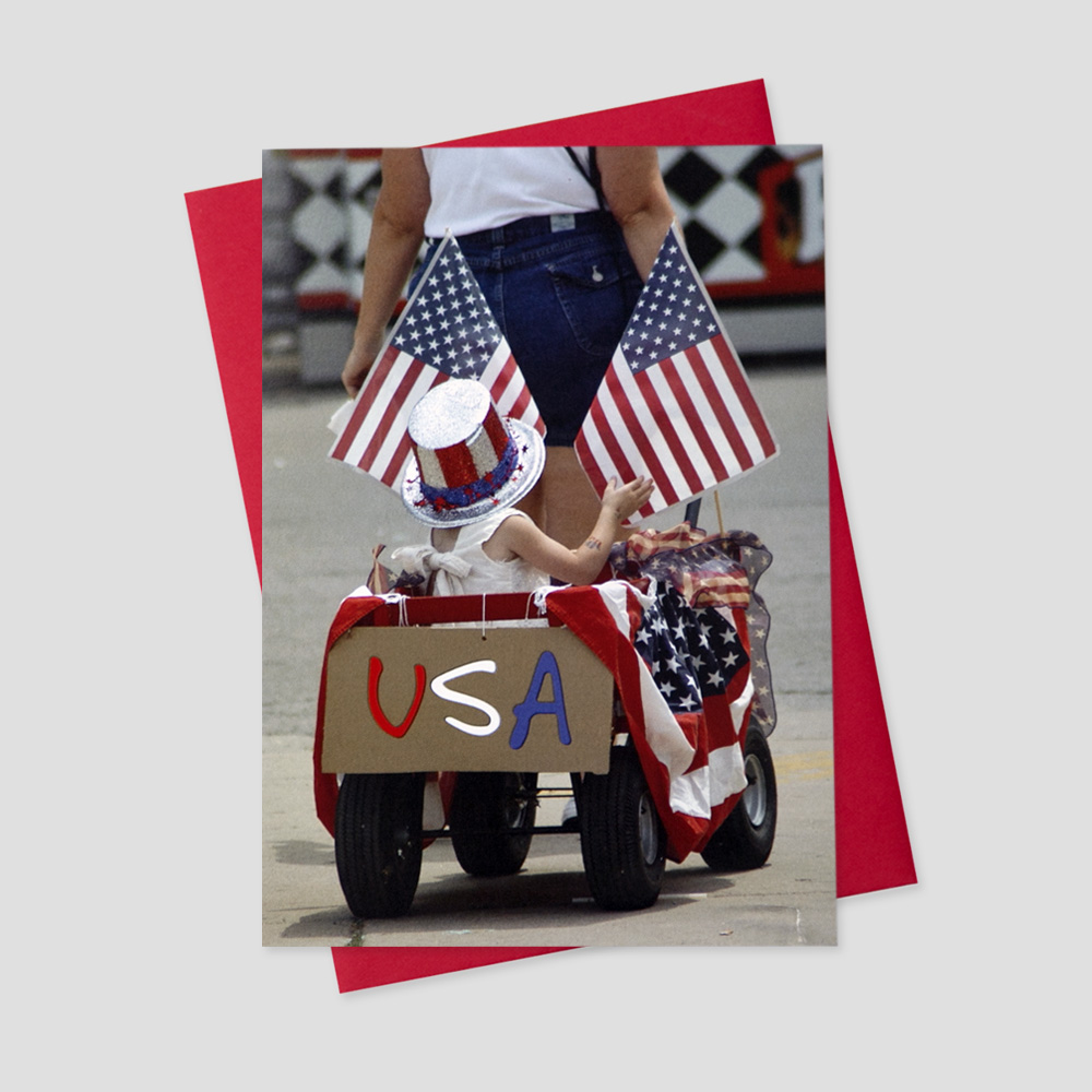 Employee Patriotic greeting card featuring a mother and daughter dressed in patriotic attire and participating in a parade