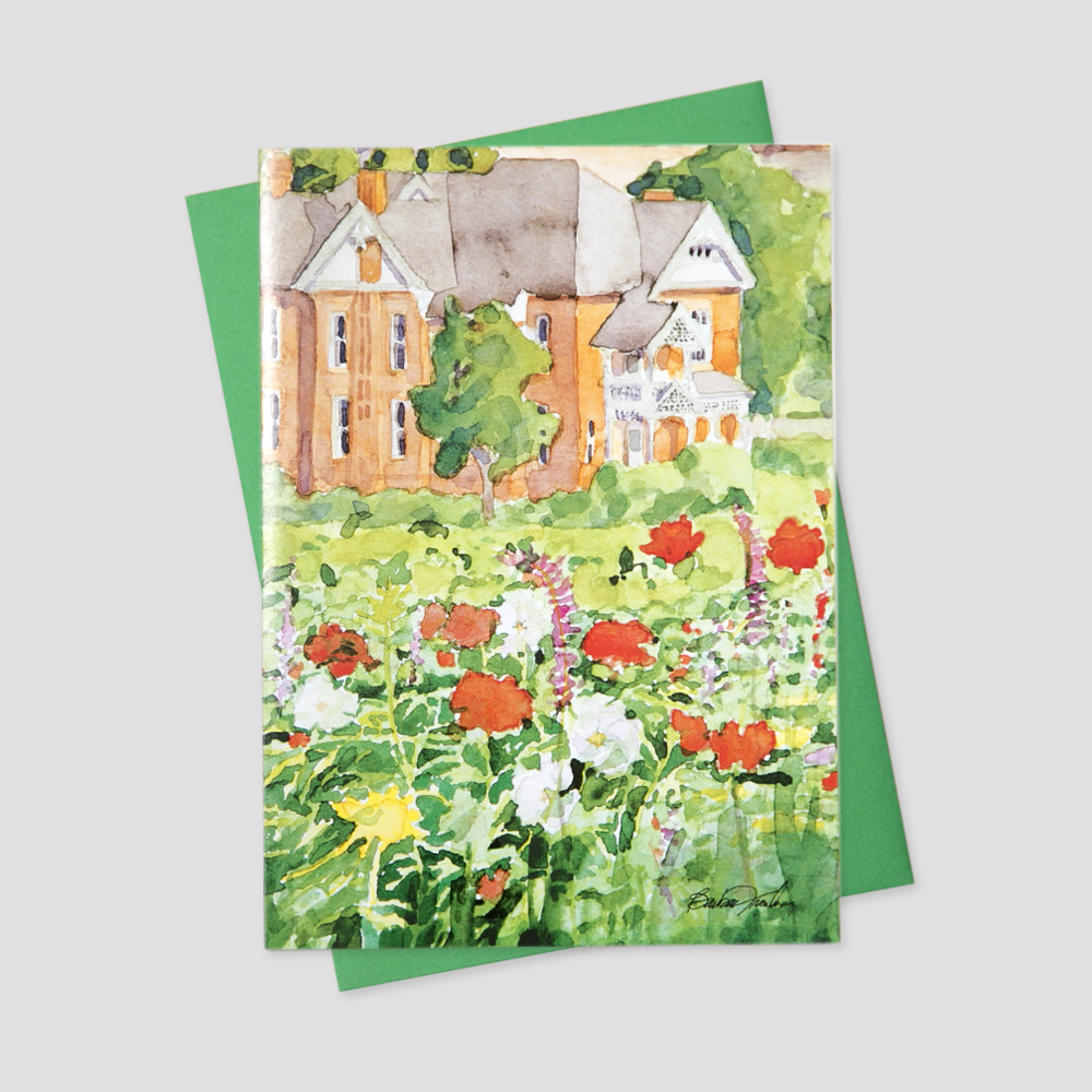 Professional Realtor greeting card featuring a watercolor image of a garden view of a brick home