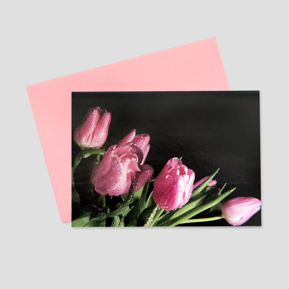 Professional Springtime greeting card featuring pink tulips amidst a black background
