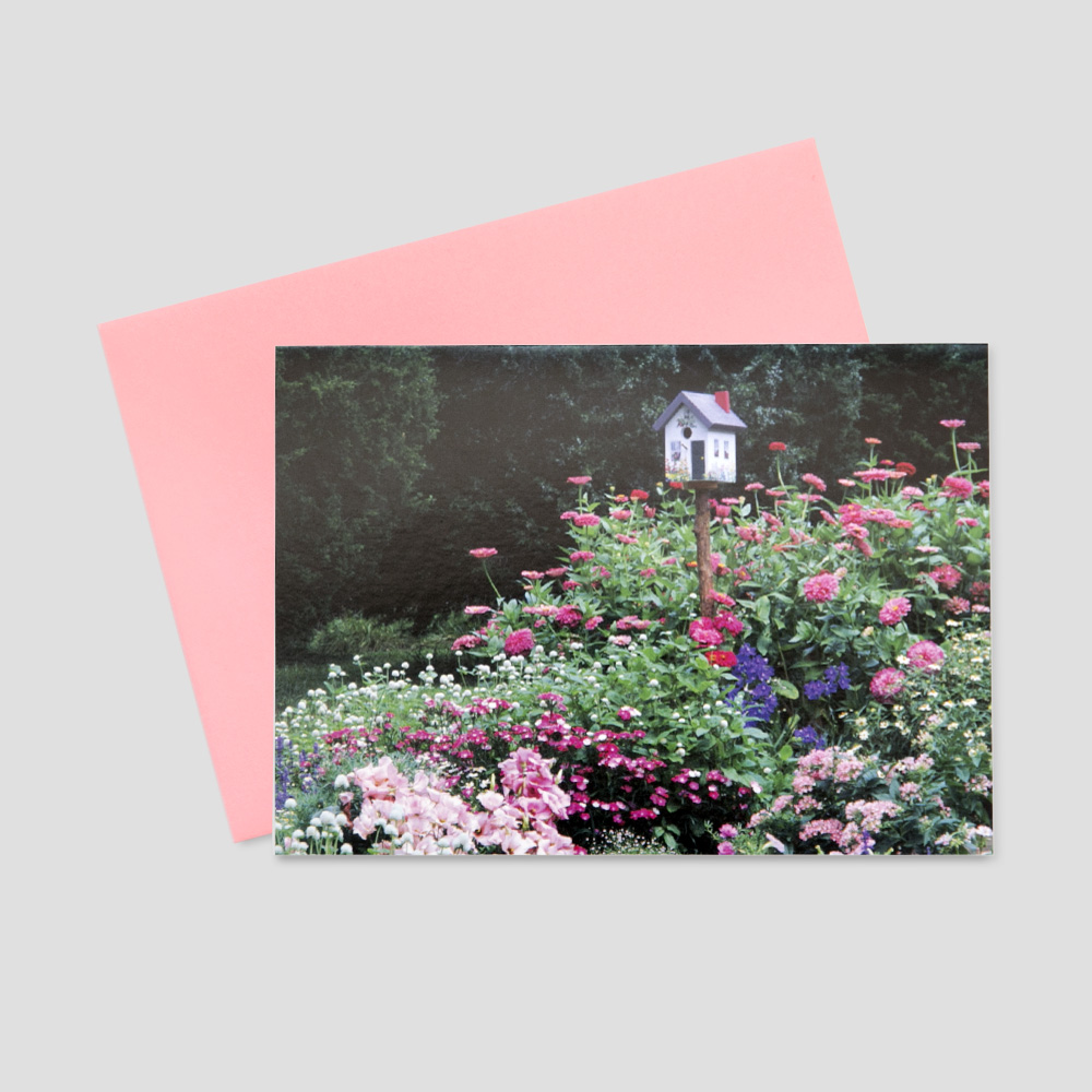 Employee Springtime greeting card featuring a bed of pink and red flowers surrounding a perched bird house