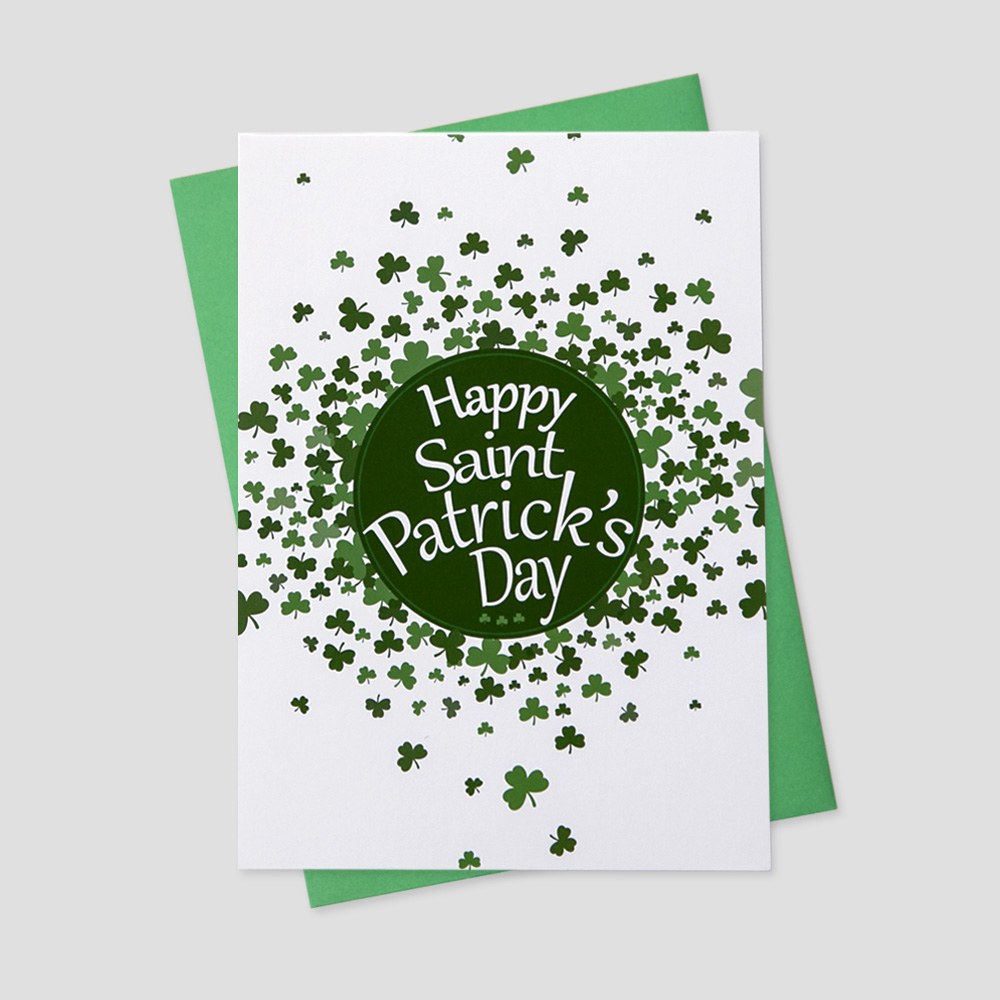 Corporate St. Patrick's Day greeting card featuring a St. Patrick's Day message on a white background surrounded by many shamrocks