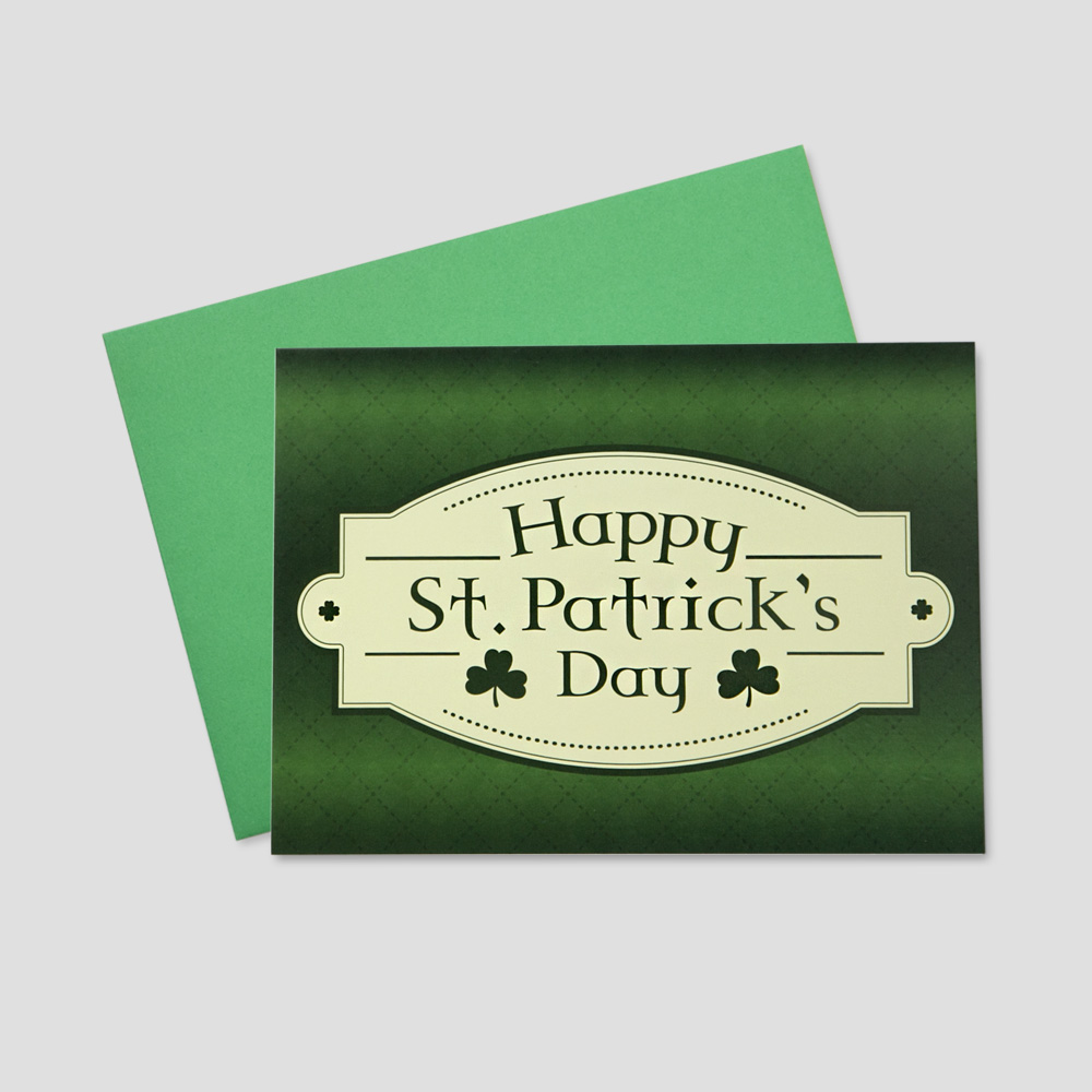 Professional St. Patrick's Day greeting card featuring a St. Patrick's Day message in an Irish font on a plaid background