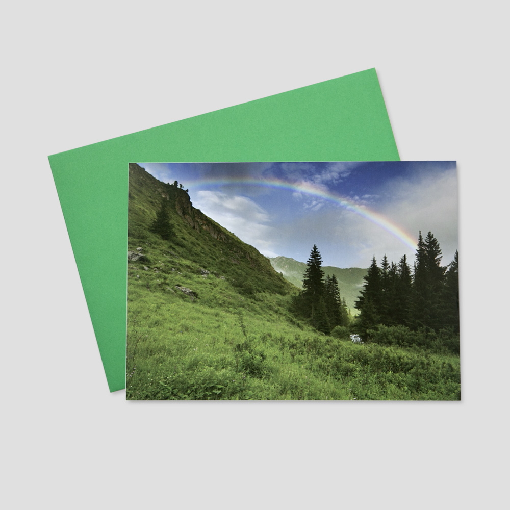 Company St. Patrick's Day greeting card featuring rolling hills and a beautiful rainbow spanning the landscape