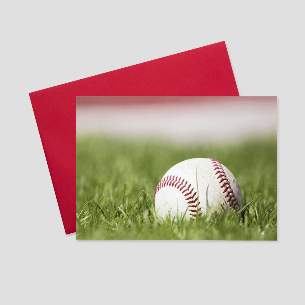 Business Summertime greeting card featuring a new baseball resting on the outfield of a baseball field