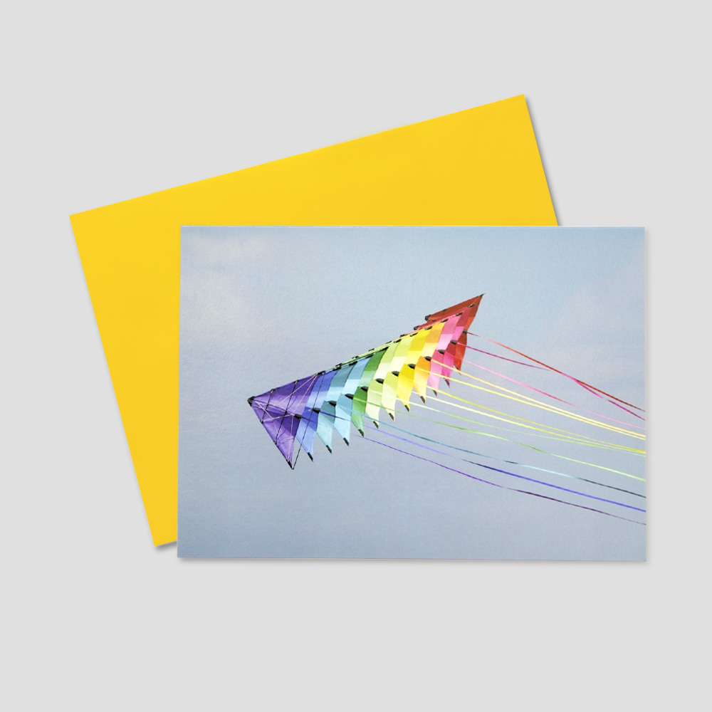 Client Summertime greeting card featuring an image of colorful kites flying through a blue sky