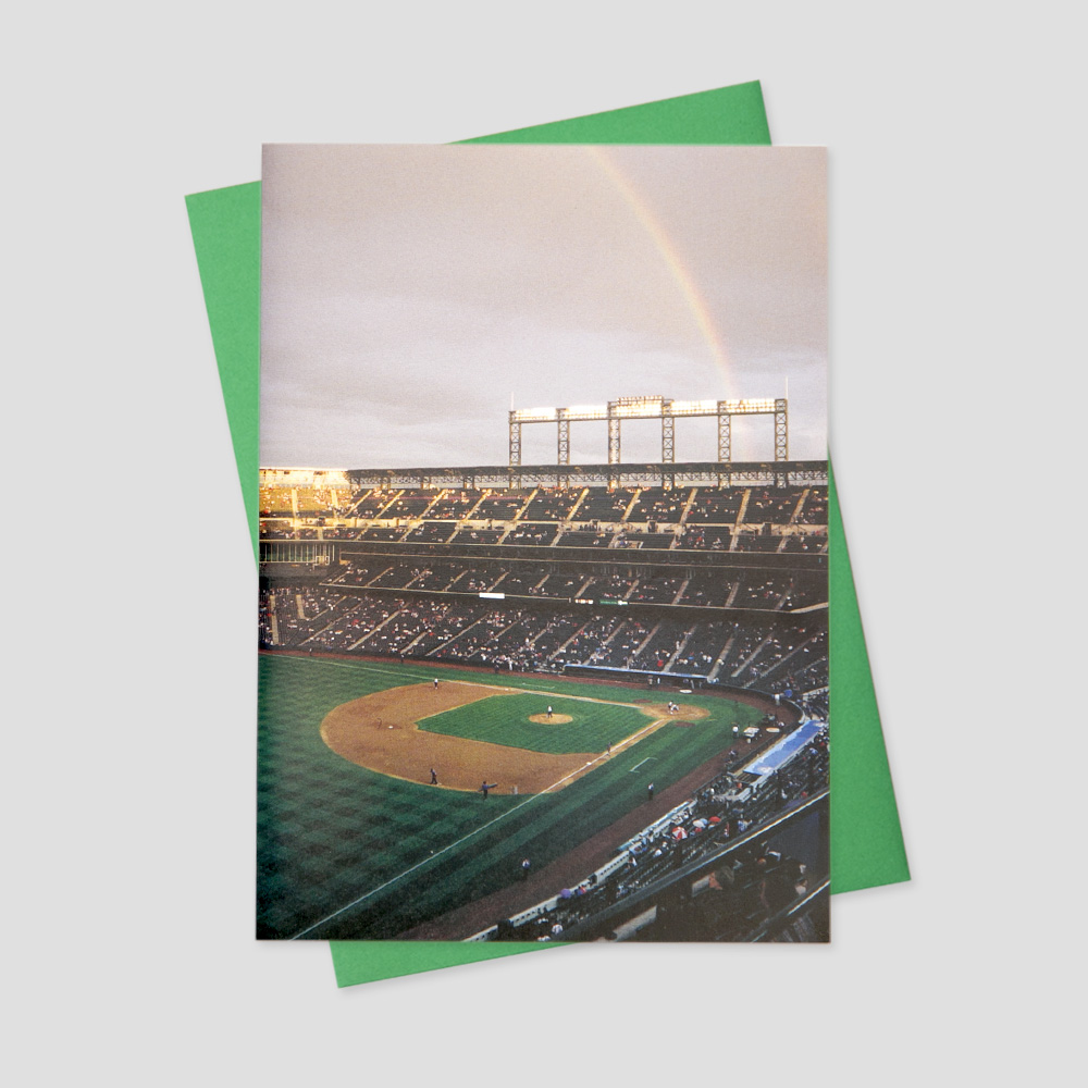 Business Summertime greeting card featuring a bird's eye view of a baseball field with a rainbow spanning the stadium