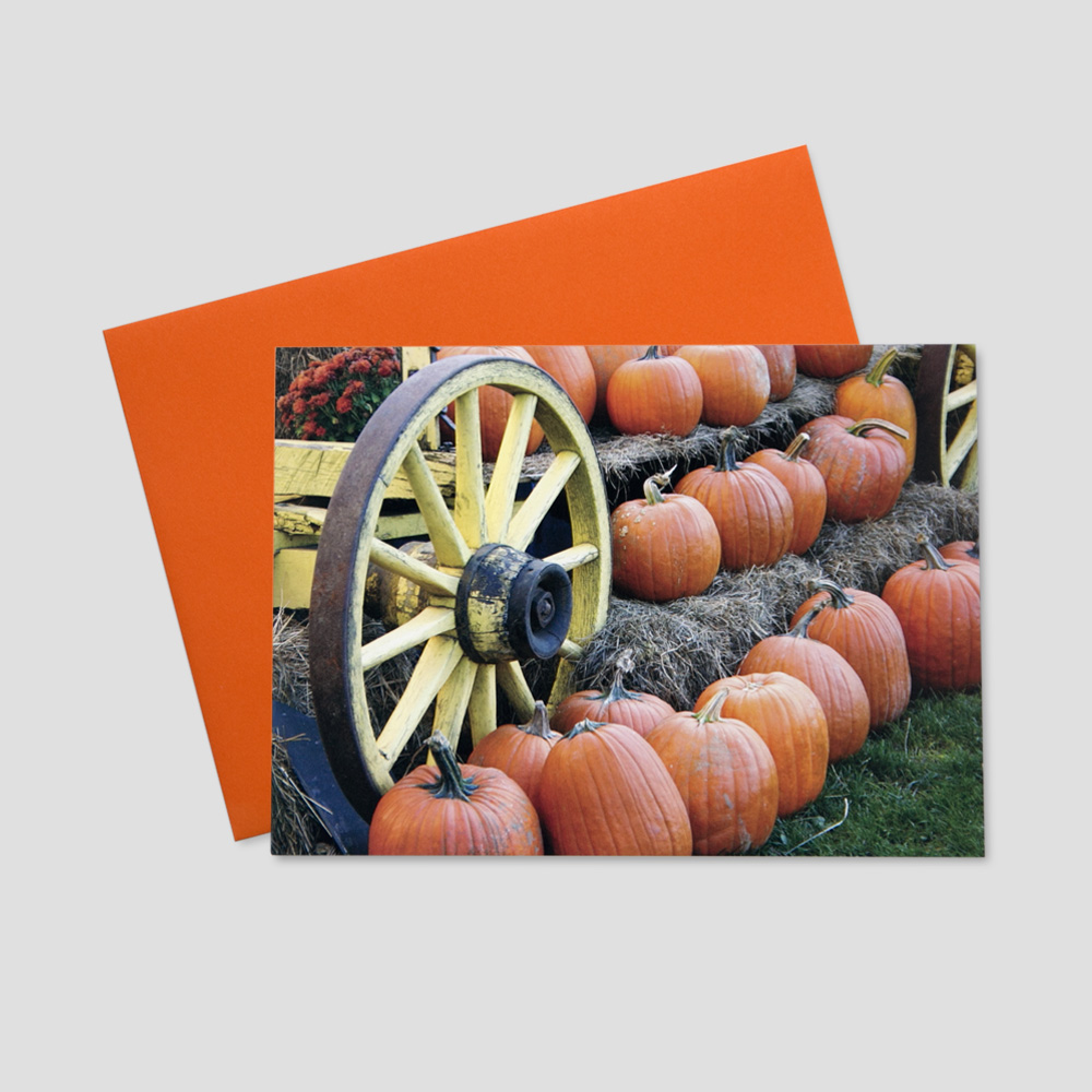 Business Thanksgiving greeting card featuring a wagon filled with the essentials for the fall season