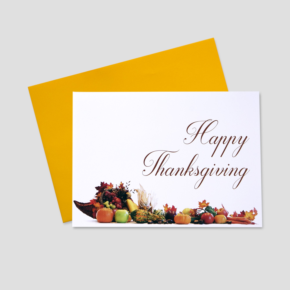 Client Thanksgiving greeting card with an image of a happy thanksgiving message in script font and a cornucopia against a white background