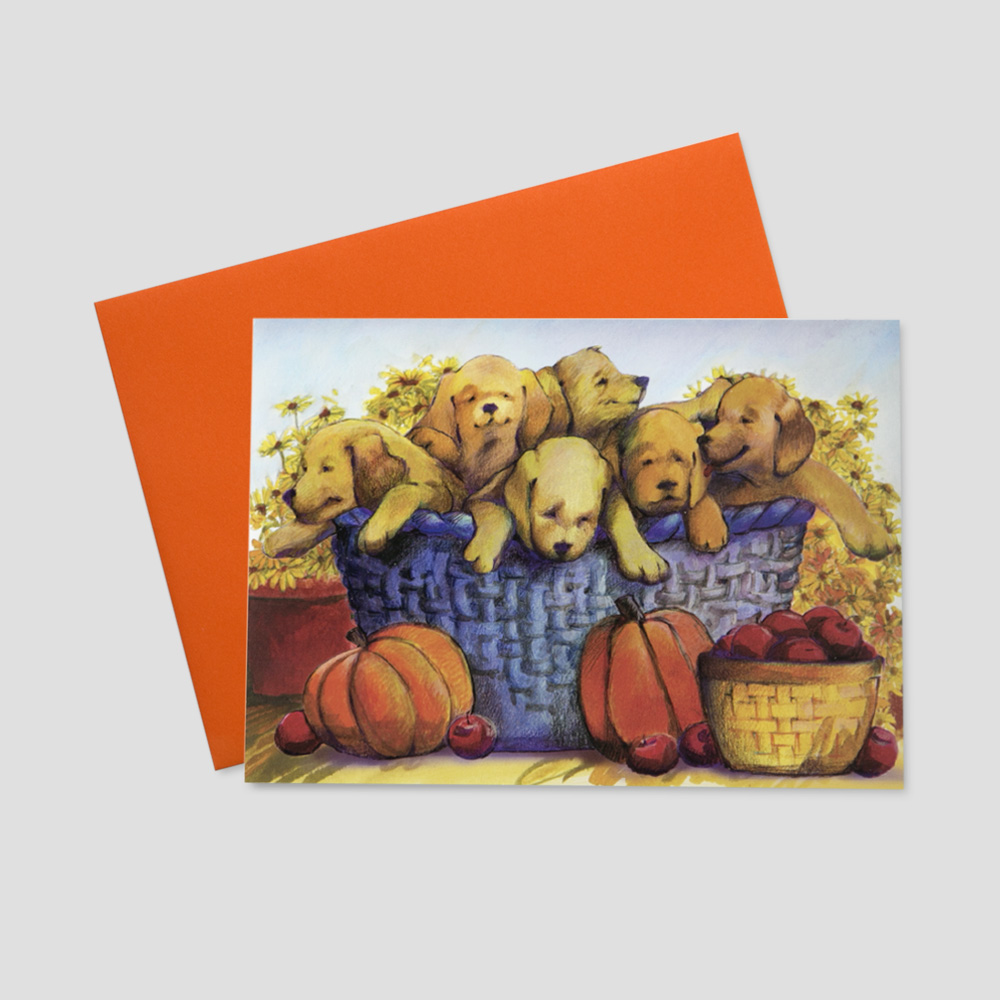 Customer Thanksgiving greeting card featuring a watercolor image of a basket of puppies surrounded by orange pumpkins