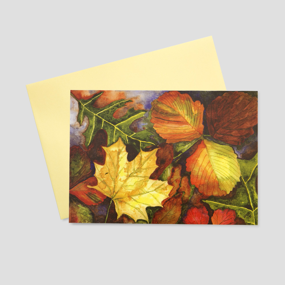 Professional Thanksgiving greeting card featuring a watercolor image of fall leaves in multiple colors