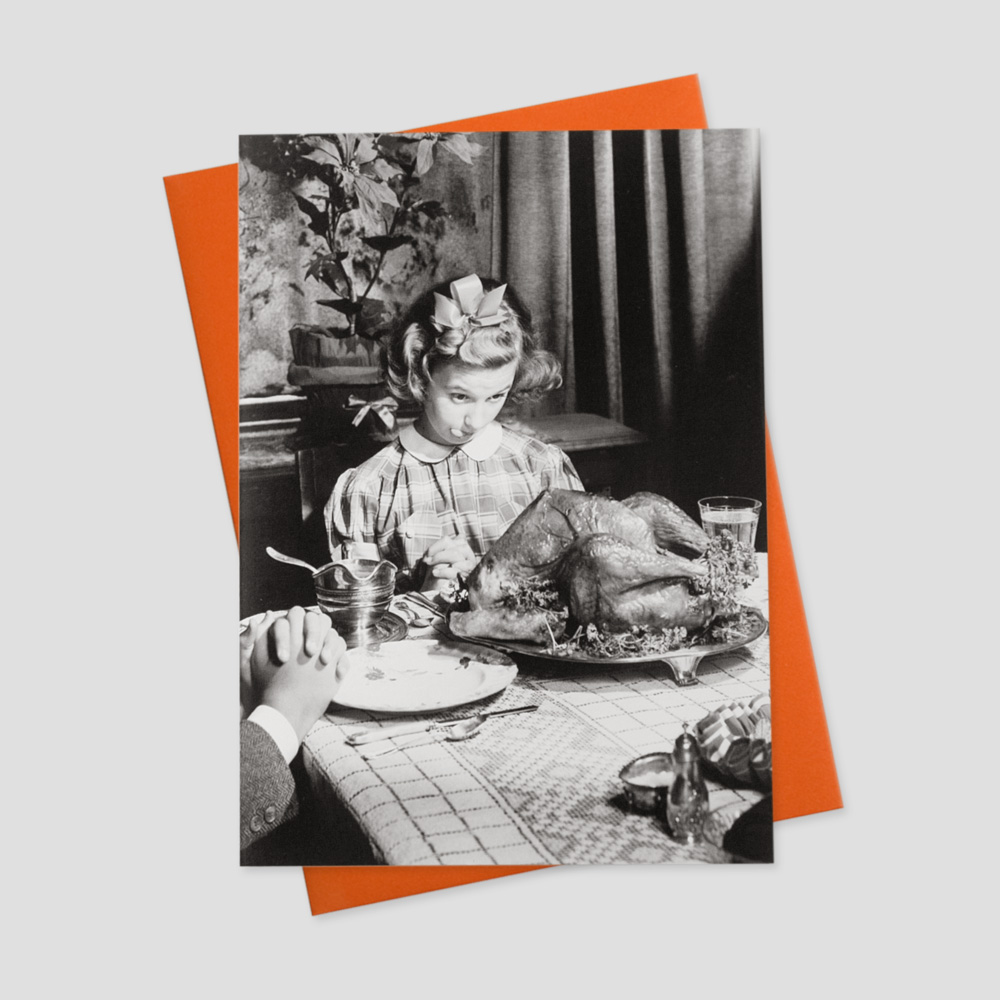 Business Thanksgiving greeting card featuring a black and white image of a girl waiting patiently to feast on a turkey at the dinner table