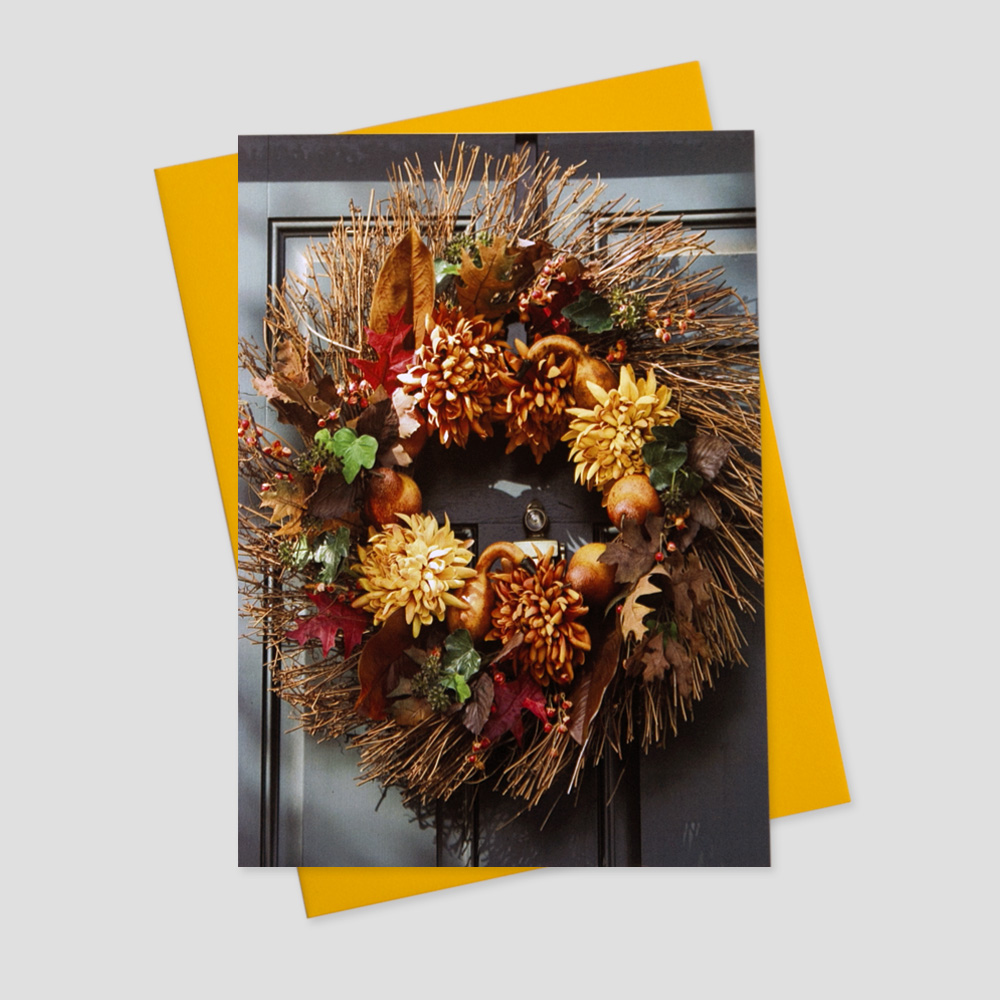 Company Thanksgiving greeting card featuring an image of a colorful autumn wreath hanging on a front door