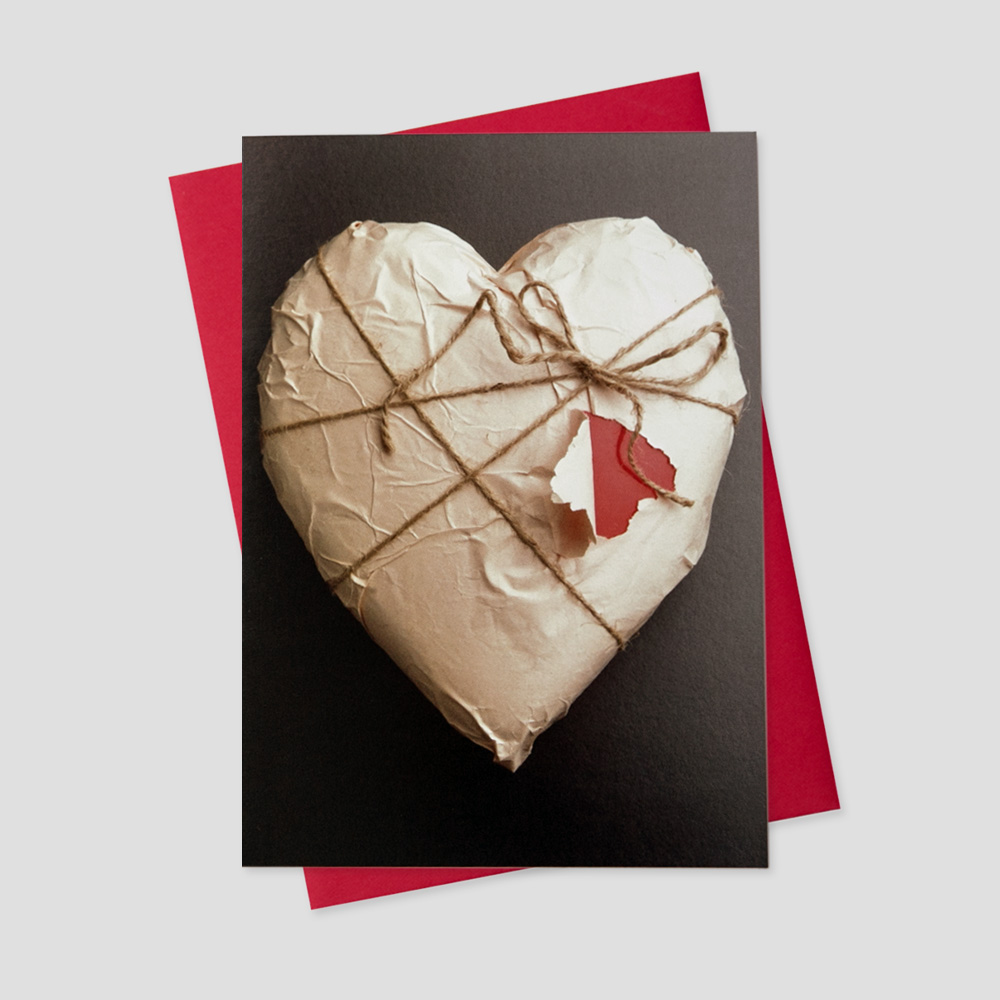 Client Valentine's Day greeting card featuring a brown package wrapped in twine in the shape of a heart