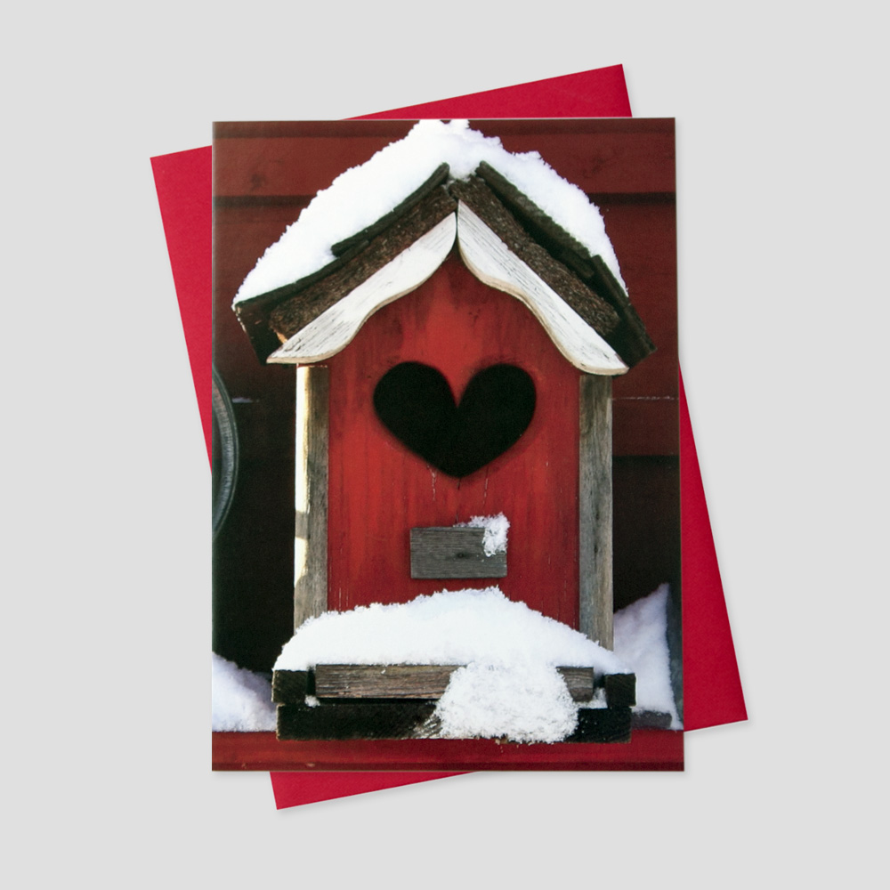 Professional Valentine's Day greeting card featuring a red bird house with a heart-shaped opening covered in white snow