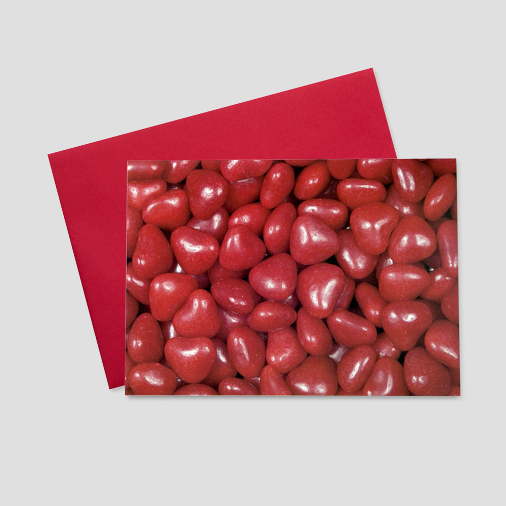 Employee Valentine's Day greeting card featuring a mountain of heart-shaped red candies