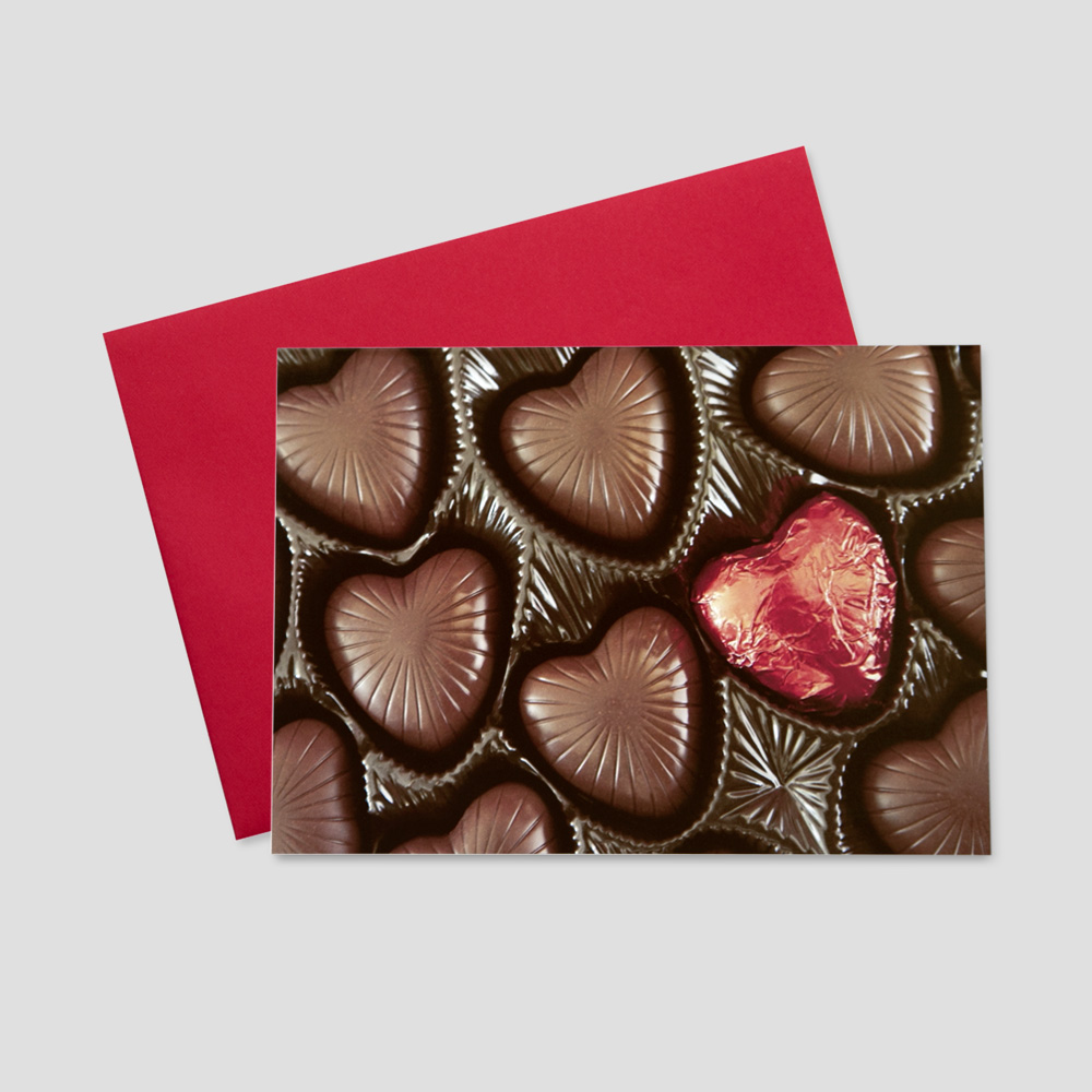 Business Valentine's Day greeting card featuring chocolate candies in a heart-shaped box with red packaging