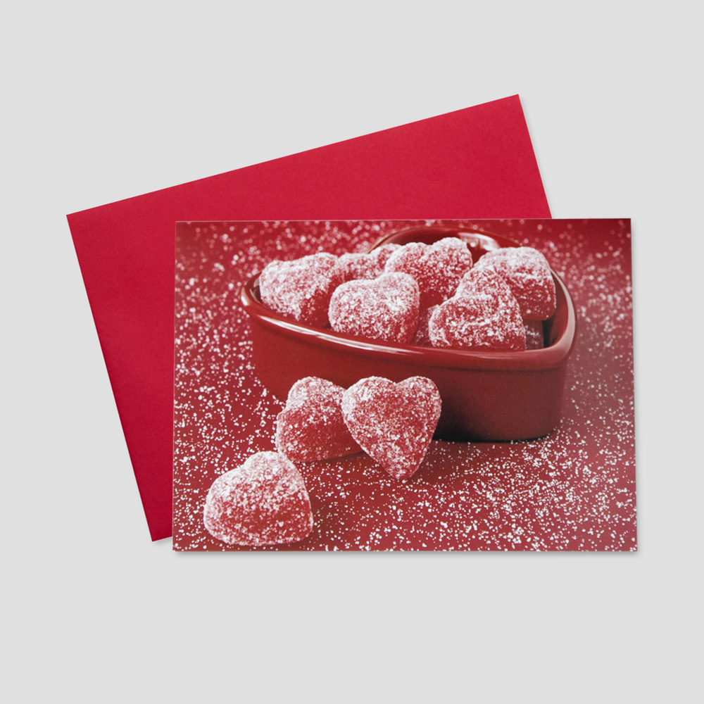 Company Valentine's Day greeting card with heart-shaped red candies in a red bowl surrounded by sugar