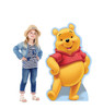 Life-size cardboard standee of Winnie the Pooh with model.