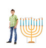 Life-size cardboard standee of Hannukkah Menora with model.