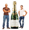 Life-size cardboard standee of a New Years Champagne Bottle. View of back and front of standee with models.