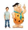 Life-size cardboard standee of Fred Flintstone with model.