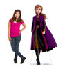 Life-size cardboard standee of Anna from Disney's Frozen 2) with model.