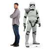Life-size cardboard standee of Stormtrooper Sergeant™ (Star Wars IX) with model.