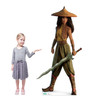Lifes-size cardboard standee of Raya from Disney's Raya and the Last Dragon with model.