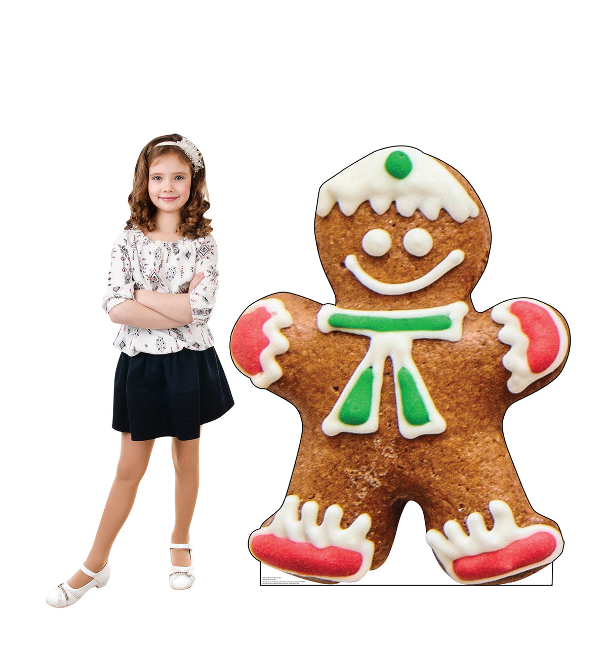 Life-size cardboard standee of Gingerbread Man Cookie with model.