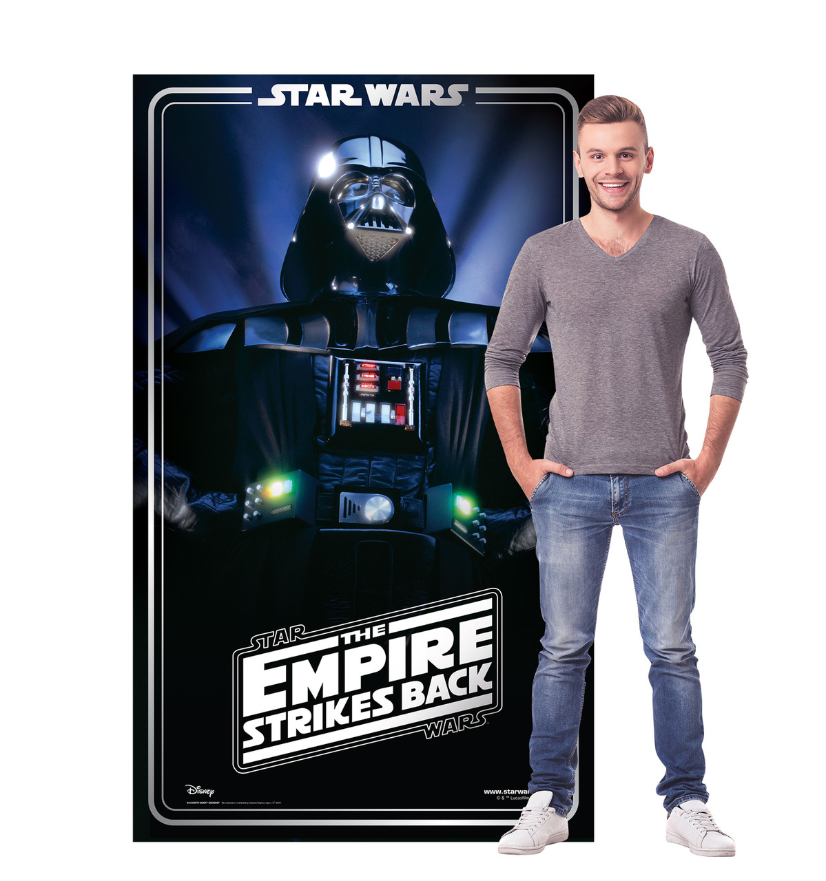 Life-size cardboard standee backdrop of Darth Vader. Celebrating 40 years, with model.