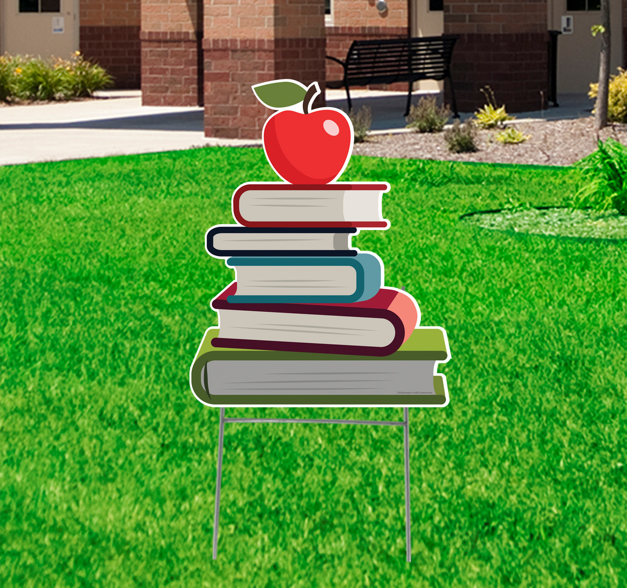 Coroplast outdoor school books with apple on top yard sign.
