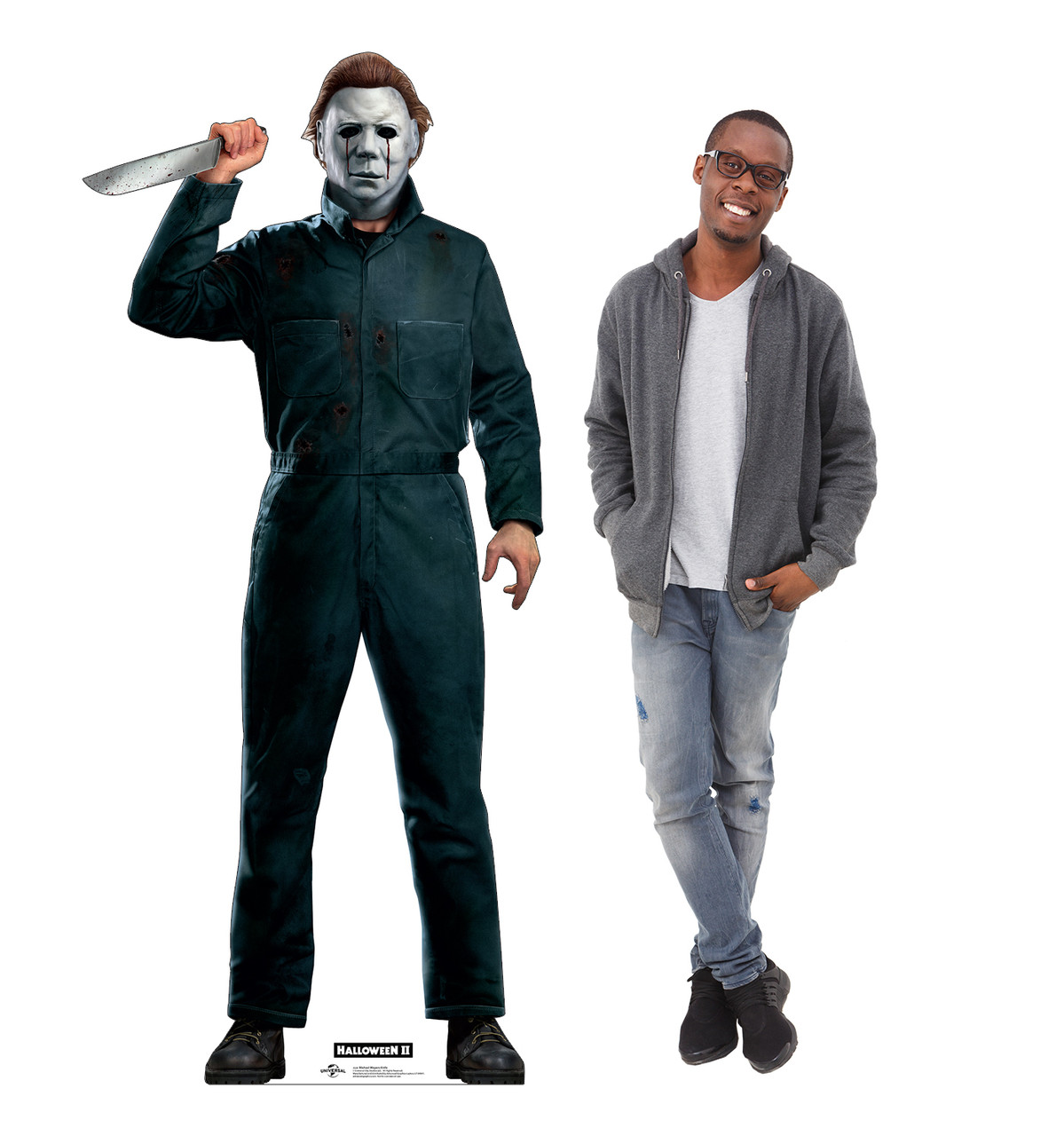 Life-size cardboard standee of Michael Myers with knife from Halloween II movie with model.